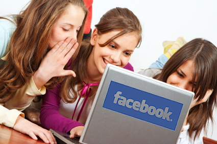 Closeup of young teenager girls having fun with internet on laptop